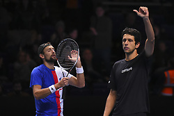 November 18, 2017 - London, England, United Kingdom - Brazil's Marcelo Melo (R) and his partner Poland's Lukasz Kubot (L) celebrate beating US player Ryan Harrison and New Zealand's Michael Venus during their men's doubles semi-final match on day seven of the ATP World Tour Finals tennis tournament at the O2 Arena in London on November 18, 2017. (Credit Image: © Alberto Pezzali/NurPhoto via ZUMA Press)