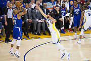 Golden State Warriors forward Omri Casspi (18) challenges LA Clippers guard C.J. Williams (9) during a three point shot attempt at Oracle Arena in Oakland, Calif., on January 10, 2018. (Stan Olszewski/Special to S.F. Examiner)