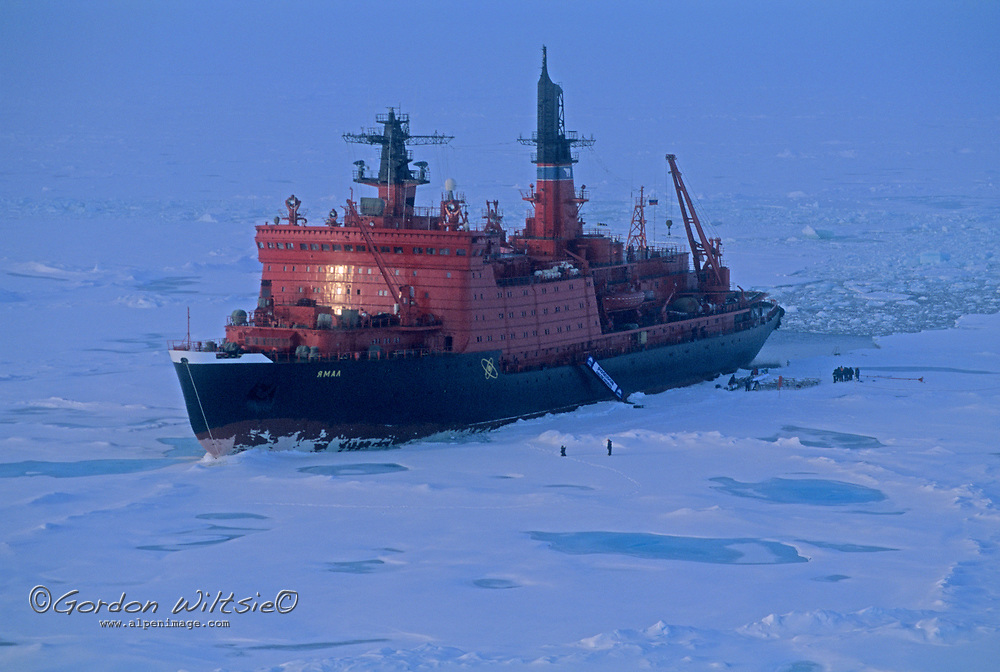 A nuclear-powered Russian icebreaker unloads tourists at the North Pole.