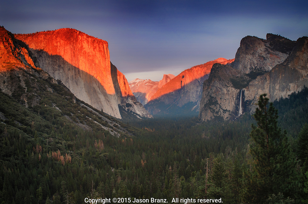 Winter sunset light on El Capitan and Half Dome from Tunnel View, Yosemite National Park, California.