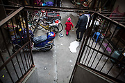 Zhao Jing and her grandpfather Zhao Benyou walk through the Wujianong neighborhood of Hefei, China, on Thursday, Nov. 26, 2015. Cheap housing in the neighbourhood and its closeness to the regional children hospital has made it a popular long term stay option for many families with kids suffering from caner, notably Leukaemia, as Surging health-care costs are turning into one of the biggest threats to the world's second largest economy and its consumers. Surging health-care costs are turning into one of the biggest threats to the world's second largest economy and its consumers.