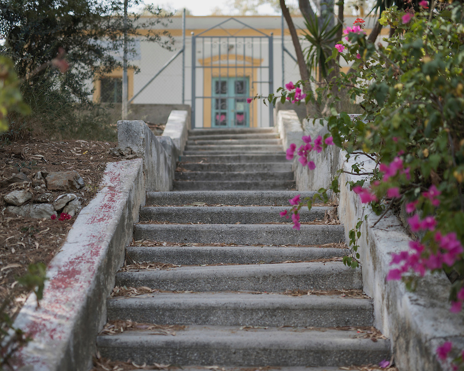 A stairway leading to the entrance of Villa Artemis, a shelter for 30 refugee women and their children in the grounds of Leros Hospital. <br /> Opened in September 2015, the shelter was run by the Leros Solidarity Network. However, Villa Artemis was closed down shortly after the opening of a 'Hotspot' (EU-run migrant's reception centres) camp in Lepida in February 2016
