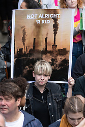 "© Licensed to London News Pictures. 31/08/2019. Manchester, UK. A placard reading "" Not alright 'r kid "" . Thousands attend a pro EU demo in Manchester City Centre and march en masse along John Dalton Street to join an Extinction Rebellion occupation of Deansgate . Objections are being raised about the Prime Minister Boris Johnson's intention to prorogue Parliament in the run up to Britain's planned Brexit deadline . Photo credit: Joel Goodman/LNP"