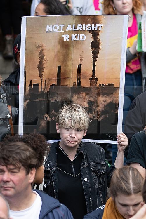 """© Licensed to London News Pictures. 31/08/2019. Manchester, UK. A placard reading """" Not alright 'r kid """" . Thousands attend a pro EU demo in Manchester City Centre and march en masse along John Dalton Street to join an Extinction Rebellion occupation of Deansgate . Objections are being raised about the Prime Minister Boris Johnson's intention to prorogue Parliament in the run up to Britain's planned Brexit deadline . Photo credit: Joel Goodman/LNP"""