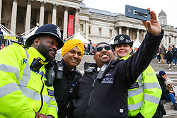 April 27, 2019 - London, UK, UK - London, UK.Police officers takes a selfie during the Vaisakhi Festival in Trafalgar Square hosted by the Mayor of London. .The Vaisakhi Festival is a religious festival that marks the Sikh New Year. This year's celebrations took place on 14 April which commemorates the beginning of Sikhism as a collective faith and London's celebrations are an opportunity for people from all communities, faiths and backgrounds to experience a festival that is celebrated by Sikhs who live in the capital and over 20 million people across the world. (Credit Image: © Dinendra Haria/London News Pictures via ZUMA Wire)