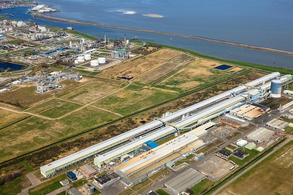 Nederland, Groningen, Delfzijl, 01-05-2013; Industrieterrein Eemsmondgebied met aluminiumsmelter ALDEL (aluminium Delfzijl) in de voorgrond en het Chemie park in de achtergrond.<br /> Industrial Estate of the Eemsmond area with aluminum smelter Aldel (aluminum Delfzijl) (foreground), on the second plan the Chemical Park.<br /> luchtfoto (toeslag op standard tarieven);<br /> aerial photo (additional fee required);<br /> copyright foto/photo Siebe Swart