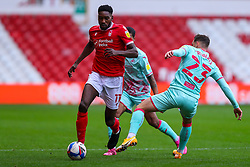 Sammy Ameobi of Nottingham Forest is tackled by Connor Roberts of Swansea City  - Mandatory by-line: Nick Browning/JMP - 29/11/2020 - FOOTBALL - The City Ground - Nottingham, England - Nottingham Forest v Swansea City - Sky Bet Championship