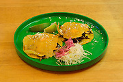 New York, NY - 11 February 2014. Tacos hongos—tacos with mushrooms, parsley and chicharron de queso at Mission Cantina, Danny Bowien's latest restaurant in New York's Lower East Side.