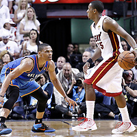 21 June 2012: Oklahoma City Thunder point guard Russell Westbrook (0) defends on Miami Heat point guard Mario Chalmers (15) during the Miami Heat 121-106 victory over the Oklahoma City Thunder, in Game 5 of the 2012 NBA Finals, at the AmericanAirlinesArena, Miami, Florida, USA. The Miami Heat wins the series 4-1.