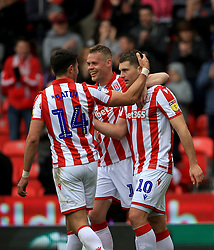 Stoke City's Sam Vokes (No 10) celebrates with team-mate Danny Batth after he scores his sides first goal.