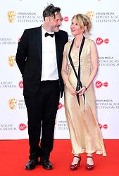 Julian Barratt and Julia Davies attending the Virgin Media BAFTA TV awards, held at the Royal Festival Hall in London. Photo credit should read: Doug Peters/EMPICS