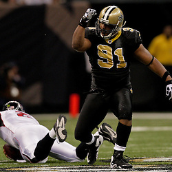 2009 November 02:  New Orleans Saints defensive end Will Smith (91) celebrates after sacking Atlanta Falcons quarterback Matt Ryan (2) during the first quarter at the Louisiana Superdome in New Orleans, Louisiana.