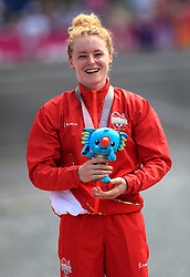 England's Annie Last with her gold medal after the Women's Cross-country at the Nerang Mountain Bike Trails during day eight of the 2018 Commonwealth Games in the Gold Coast, Australia.