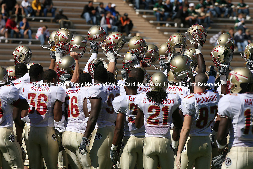 14 October 2006: Florida State's players hold their helmets in the air as they huddle before the game. The Florida State University Seminoles defeated the Duke University Blue Devils 51-24 at Wallace Wade Stadium in Durham, North Carolina in an Atlantic Coast Conference NCAA Division I College Football game.
