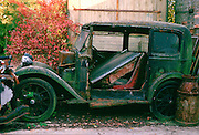 A run-down 1933 Austin classic motor car awaiting restoration and renovation in Gloucestershire, United Kingdom