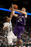 Northwestern's John Shurna is fouled by Penn State's Tim Frazier while shooting a layup during the second half of the Nittany Lions home game against Northwestern Saturady, February 13, 2011 at the Bryce Jordan Center in University Park, PA.