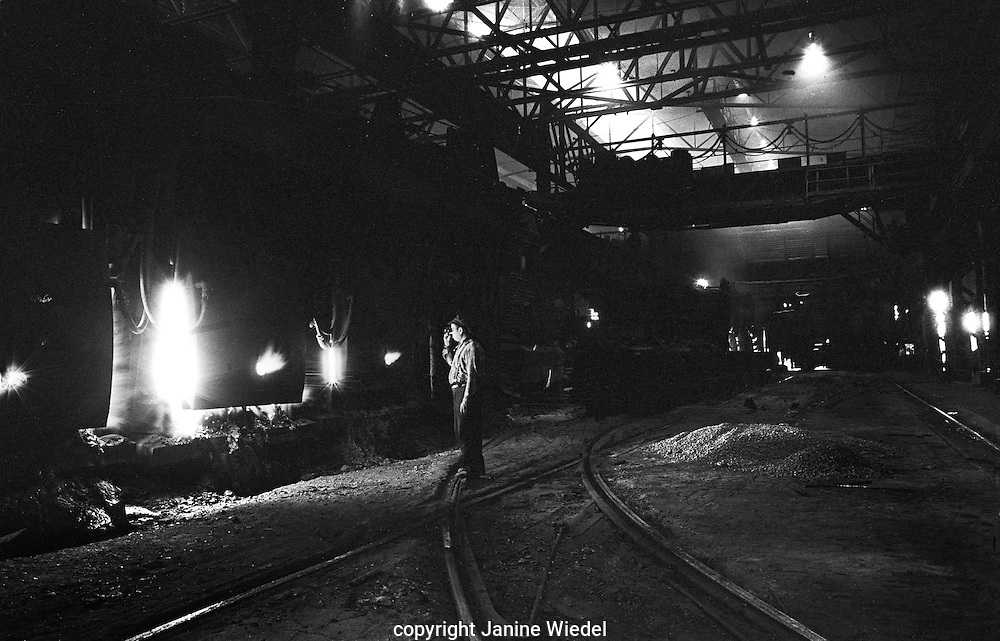 Monitoring the progress of steelmaking.The melting shop at Bilston Steelworks Open Hearth furnace in the Black Country West Midlands in the 1978