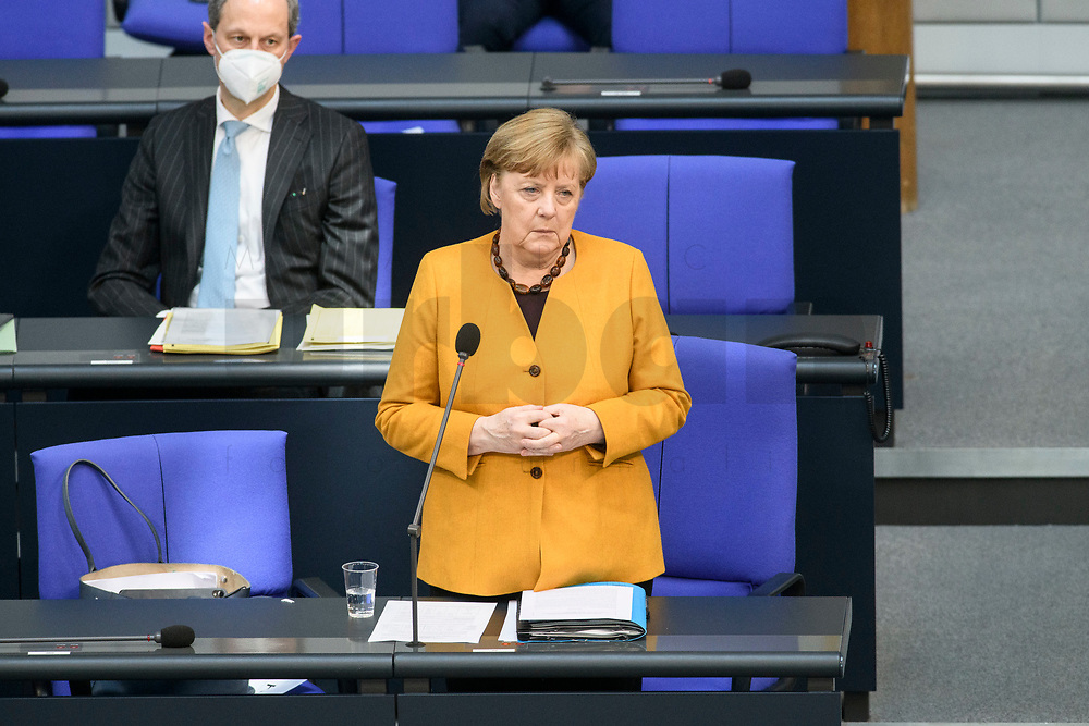 24 MAR 2021, BERLIN/GERMANY:<br /> Angela Merkel, CDU, Bundeskanzlerin, waehrend der Regierungsbefragung durch den Bundestag zur Bekaempfung der Corvid-19 Pandemie, Plenarsaal, Reichstagsgebaeude, Deutscher Bundestag<br /> IMAGE: 20210324-01-021<br /> KEYWORDS: Corona