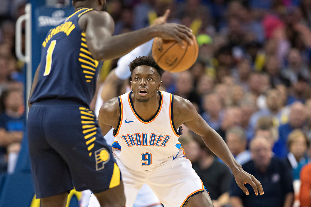 OKLAHOMA CITY, OK - OCTOBER 25:  Jerami Grant #9 of the Oklahoma City Thunder playing defense against Lance Stephenson #1 of the Indiana Pacers at the Chesapeake Energy Arena on October 25, 2017 in Oklahoma City, Oklahoma.  NOTE TO USER: User expressly acknowledges and agrees that, by downloading and or using this photograph, User is consenting to the terms and conditions of the Getty Images License Agreement.  The Thunder defeated the Pacers 114-96.  (Photo by Wesley Hitt/Getty Images) *** Local Caption *** Jerami Grant; Lance Stephenson