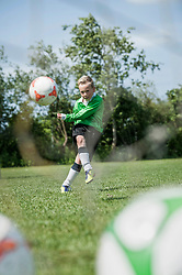 Young junior boy soccer player practicing penalty