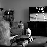 Leo sits on his recliner at his home in Skiatook, Oklahoma, Saturday, Sept. 10, 2016, as he shows a video about his prosthetic leg to demonstrate how he has to walk after his amputation. His computerized prosthetic makes it possible to do his maintenance job at American Airlines. Kurt Steiss/O'Colly