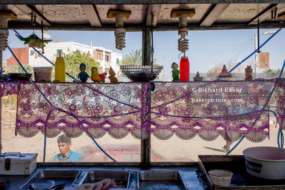 Detail of a street vendor's food stall in a street cafe in Kharga Oasis in the Western Desert, Egypt.