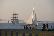 Newport, RI 2007 - Classic Twelve meter yacht sails past anchored tallship - Tallships from around the world congregated in Newport for the summer of 2007 Tallships festival.