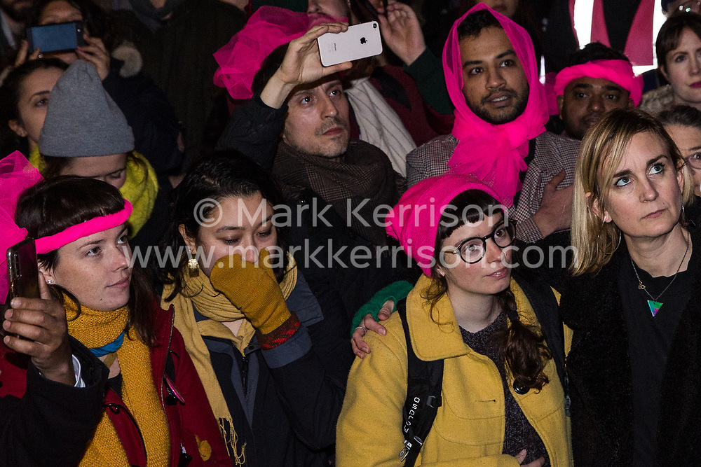 London, UK. 11th December, 2018. Members of the Stansted 15 listen to a mother addressing protesters gathered outside the Home Office to protest against their conviction using an anti-terrorism offence under the Aviation and Maritime Security Act 1990 following non-violent direct action to try to prevent a Home Office deportation flight carrying immigrants to Nigeria, Ghana and Sierra Leone from taking off from Stansted airport in March 2017. The judge directed the jury to disregard evidence put forward in their defence that their acts were intended to stop human rights abuses.
