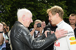 © Licensed to London News Pictures. 30/06/2012 .Sebastian Vettel with John Surtees (left) at The Goodwood Festival of Speed..The Goodwood Festival of Speed is the largest motoring garden party in the world - a unique summer weekend, The largest car culture event in the world. Held in the grounds of Goodwood House,Chichester..Photo credit : Grant Falvey/LNP
