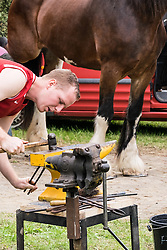 A blacksmith shaping metal at the Essex Country Show, Barleylands, Essex.