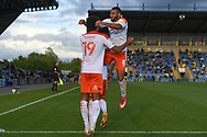 Goal Blackpool forward (on loan from Everton) Ellis Simms (19)scores a goal and celebrates  with Blackpool forward Keshi Anderson (8) 0-3 during the EFL Sky Bet League 1 play off 1st leg match between Oxford United and Blackpool at the Kassam Stadium, Oxford, England on 18 May 2021.