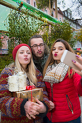 Friends pouting for selfie