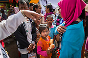 16 JUNE 2014 - POIPET, CAMBODIA:  Cambodian migrants are told how they are going to be returned to their home villages after they fled Thailand. More than 150,000 Cambodian migrant workers and their families have left Thailand since June 12. The exodus started when rumors circulated in the Cambodian migrant community that the Thai junta was going to crack down on undocumented workers. About 40,000 Cambodians were expected to return to Cambodia today. The mass exodus has stressed resources on both sides of the Thai/Cambodian border. The Cambodian town of Poipet has been over run with returning migrants. On the Thai side, in Aranyaprathet, the bus and train station has been flooded with Cambodians taking all of their possessions back to Cambodia. PHOTO BY JACK KURTZ