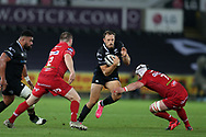 Cory Allen of the Ospreys © runs past Ken Owens (2) and Will Boyde of the Scarlets (7). Guinness Pro14 rugby match, Ospreys v Scarlets at the Liberty Stadium in Swansea, South Wales on Saturday 7th October 2017.<br /> pic by Andrew Orchard, Andrew Orchard sports photography.