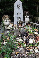 Tanuki Badgers at Yashima-ji  - Yashima-ji is a Shingon temple in Yashima, a lava plateau to the northeast of Takamatsu, Kagawa Prefecture, Japan. A branch temple of Ninna-ji in Kyoto, it is the eighty-fourth temple on the Shikoku 88 temple pilgrimage.  The Main Hall and bell tower of Yashima-ji still stands after its construction during the Kamakuraera at the beginning of the 14th century and classified as an Important Cultural Property. The temple grounds also contain large, stone images ofMinoyama Daimyojin, a rascally tanuki raccoon dog that is able to change shape and assume other forms. There are legends of the tanuki meeting Kobo Daishi in the shape of an old man though now the portly, large-testicled Minoyama Daimyojin is a demi-god who bestows good fortune on married couples andmizushobaibar enterprises.