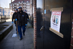 © Licensed to London News Pictures. 09/03/2021. London, UK. A police search team passes a missing poster as they look for missing 33 year old woman Sarah Everard near in Brixton Hill, south London. Police are concerned for the safety of Ms Everard who has been missing for six days after leaving a friend's house in Leathwaite Road, Clapham, London. She is thought to have walked across Clapham Common, and was due to arrive home in Brixton 50 minutes later. Photo credit: Peter Macdiarmid/LNP