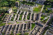 Nederland, Zuid-Holland, Rotterdam, 15-07-2012; Pendrecht (deelgemeente Charlois, Rotterdam-Zuid). Oostelijk detail, flats en eengezinswoningen..Nieuwbouwwijk uit de jaren vijftig van de vorige eeuw, wederopbouw periode. Stedenbouwkundig ontwerp van Lotte Stam-Beese, kenmerkend zijn de ruime opzet en  veel groen. Ontworpen als wijk met verschillende woningtypen (en verschillende bewoners) en voorzien van alle voorzieningen..Pendrecht (part of Charlois, Rotterdam-South). New neighborhood (fifties of the last century), post-war reconstruction period. Urban design of Lotte Stam-Beese, characterized by spacious layout and lots of green. Designed as residential district with different housing types.. .QQQ.luchtfoto (toeslag), aerial photo (additional fee required).foto/photo Siebe Swart