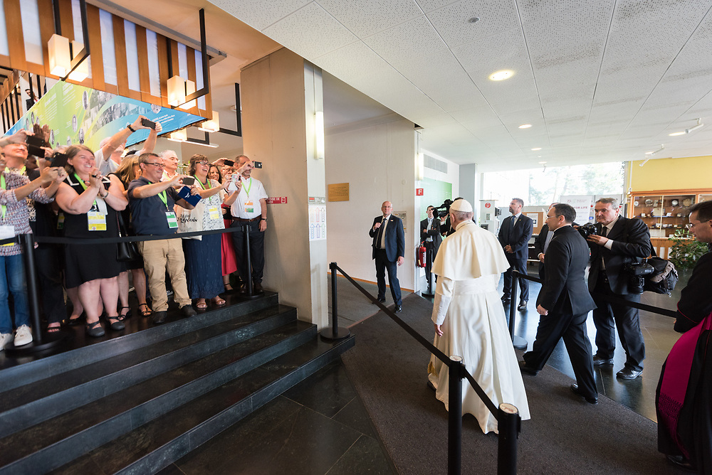 """21 June 2018, Geneva, Switzerland: On 21 June 2018, the World Council of Churches receives a visit from Pope Francis of the Roman Catholic Church. Held under the theme of """"Ecumenical Pilgrimage - Walking, Praying and Working Together"""", the landmark visit is a centrepiece of the ecumenical commemoration of the WCC's 70th anniversary. The visit is only the third by a pope, and the first time that such an occasion was dedicated to visiting the WCC. Here, Pope Francis received by WCC staff and friends."""