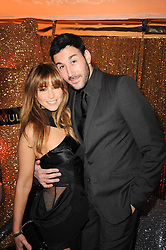 RACHEL STEVENS and ALEX BOURNE at a party to celebrate the Mulberry Autumn Winter 2010 collection held at The Orangery, Kensington Palace, London on 21st February 2010.