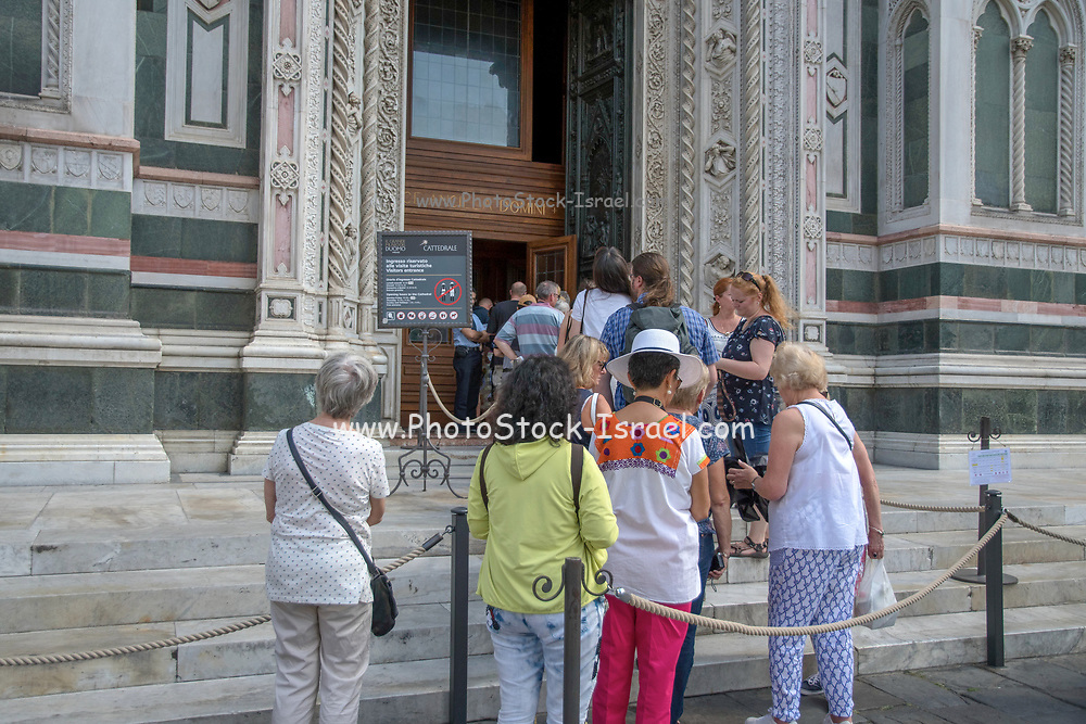 Florence, the domed cathedral of the city, Santa Maria del Fiore, known as The Duomo. Tourists wait in line to enter the landmark