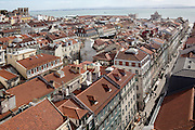 View of Baixa district with Tagus river in the background, from the walkway at the top of Elevador de Sta. Justa. This lift, built in 1902 with 45 metres tall, links the higher districts with Baixa in the hill directly opposite to the castle, in central Lisbon.