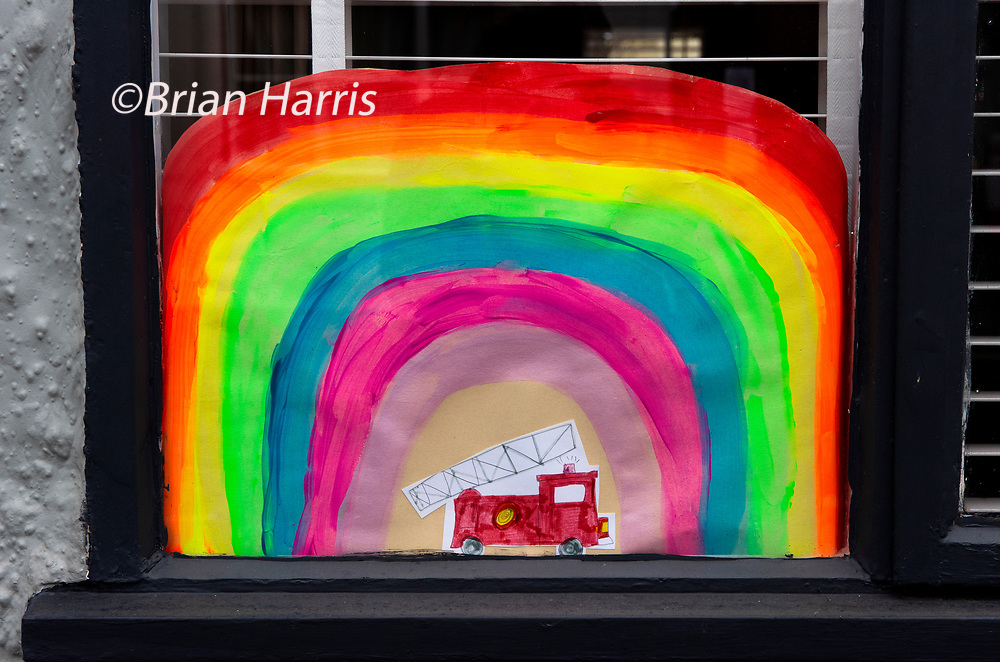 Coronovirus Lock Down. Thaxted Essex England. Rainbow salutes to NHS and all essential workers. 29 April 2020<br />Childrens drawings of a rainbow decorate many windows in Thaxted Essex UK as a show of support for the NHS (National Health Service) and all essential workers during the Coronavirus pandemic lock dow,. Photograph by Brian Harris / Alamy Live News