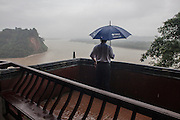 A man looks at the river near Leshan in China