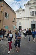 Tourists outside Bastia Cathedral in the Citadelle on 16th September 2017 in Bastia, Corsica, France. Bastia is a French commune in the Haute-Corse department of France located in the north-east of the island of Corsica at the base of Cap Corse. Bastia is the principal port and commercial town of the island. The inhabitants of Bastia are known as Bastiais or Bastiaises.