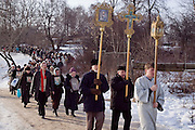 Moscow, Russia, 19/01/2005.Russian priests and Orthodox believers celebrate Epiphany at Serebryany Bor in northern Moscow. Priests blessed the waters and followers baptised themselves by total immersion in the freezing Moscow River through ice holes cut in the shape of a cross.
