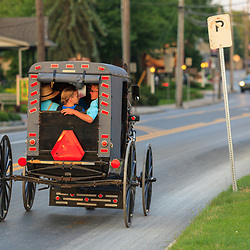 Intercourse, PA - June 22, 2013: A crowded buggy on the Old Philadelphia Pike in Lancaster County.