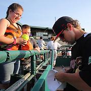 Brandon Waring, New Britain Rock Cats, signs autographs before the New Britain Rock Cats Vs Binghamton Mets Minor League Baseball game at New Britain Stadium, New Britain, Connecticut, USA. 2nd July 2014. Photo Tim Clayton