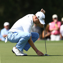 September 21, 2017 - Atlanta, Georgia, United States - Justin Thomas lines up a putt on the 3rd green during the first round of the TOUR Championship at the East Lake Club. (Credit Image: © Debby Wong via ZUMA Wire)