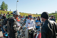 Erin Maneely and Jacob Johnson of Andover, NH register with Kathleen Holoubek for the Community Appreciation Ride held at NHMS Saturday morning to benefit the Boys and Girls Club of the Lakes Region.  (Karen Bobotas/for the Laconia Daily Sun)