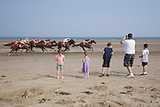 4th September 2014. Riders on the sands in the annual horse race meeting on the beach at Laytown, County Meath, Ireland.